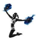 Silhueta cheerleading do líder da claque da jovem mulher Fotografia de Stock Royalty Free