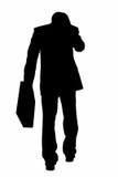 Silhueta com o trajeto de grampeamento do homem de negócio com pasta e Imagem de Stock