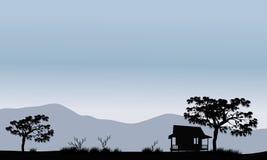 Silhueta da cabana com árvores Fotos de Stock