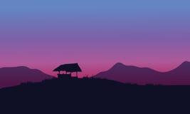 Silhueta da cabana com fundos roxos Fotografia de Stock