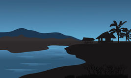 Silhueta da cabana no riverbank Fotografia de Stock Royalty Free