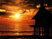 Silhueta da casa sobre o mar Imagens de Stock