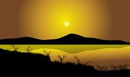 Silhueta da grama no lago Imagem de Stock Royalty Free