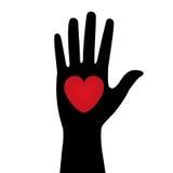 Silhueta da mão com um coração vermelho Fotos de Stock Royalty Free