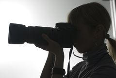 Silhueta da menina em uma lição do photoschool Foto de Stock Royalty Free