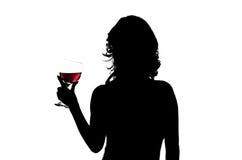 Silhueta, mulher que guardara o vidro de vinho Fotos de Stock