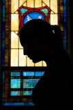 Silhueta da oração imagens de stock