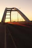 Silhueta da ponte com céu colorido Fotos de Stock
