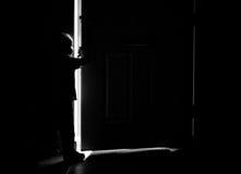 Silhueta da porta e do menino Foto de Stock Royalty Free