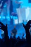 Silhueta das mãos levantadas Imagem de Stock Royalty Free