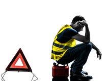 Silhueta de advertência do triângulo da veste do amarelo do acidente do homem Fotografia de Stock