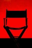 Silhueta de Cadeira do diretor no estágio vermelho Imagem de Stock