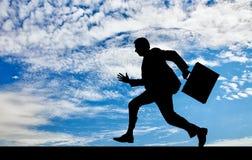 Silhueta de homem de negócios running Imagem de Stock Royalty Free
