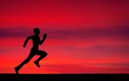 Silhueta de homem running Fotos de Stock