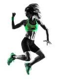 Silhueta de salto dos exercícios da aptidão da mulher fotografia de stock royalty free