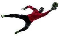 Silhueta de travamento da bola do homem caucasiano do goleiros do jogador de futebol Fotos de Stock