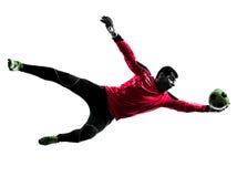 Silhueta de travamento da bola do homem caucasiano do goleiros do jogador de futebol Fotografia de Stock Royalty Free