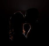 Silhueta de um beijo Imagens de Stock