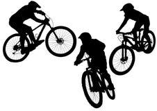 Silhueta de um ciclista em três circunstâncias diferentes fotografia de stock