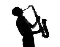Silhueta de um homem que joga o saxofone Foto de Stock Royalty Free