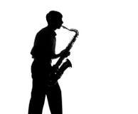 Silhueta de um homem que joga o saxofone Imagem de Stock Royalty Free
