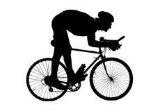 Silhueta de um homem que monta uma bicicleta ilustração royalty free