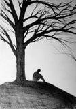 Silhueta de um homem sob a árvore Imagens de Stock