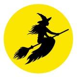 Silhueta de uma bruxa em um cabo de vassoura Foto de Stock Royalty Free