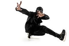 A silhueta de uma dança masculina do dançarino da ruptura do hip-hop no fundo branco imagem de stock royalty free