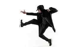 A silhueta de uma dança masculina do dançarino da ruptura do hip-hop no fundo branco fotos de stock