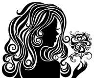 Silhueta de uma menina com uma flor Imagens de Stock Royalty Free