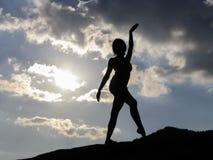 Silhueta de uma menina de dança Imagem de Stock Royalty Free