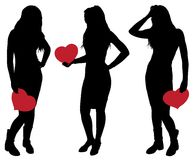 Silhueta de uma menina que guarda um coração Imagem de Stock Royalty Free