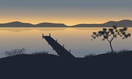 Silhueta do cais no lago Imagens de Stock Royalty Free