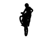 A silhueta do cavaleiro do motocross salta isolado no fundo branco Imagem de Stock Royalty Free