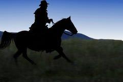 Silhueta do cowboy Imagens de Stock Royalty Free