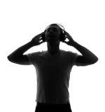 Silhueta do DJ com auscultadores Imagens de Stock Royalty Free