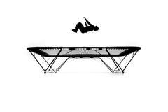 Silhueta do gymnast no trampoline imagem de stock