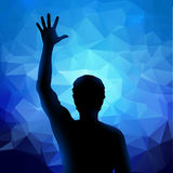 Silhueta do homem com mão levantada Fotografia de Stock