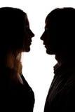 Silhueta do homem e da mulher fotografia de stock royalty free