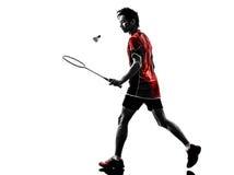 Silhueta do homem novo do jogador do badminton Fotografia de Stock