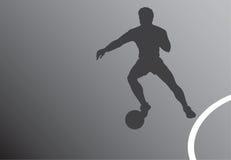 Silhueta do jogador de futebol Fotografia de Stock Royalty Free