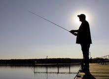 Silhueta do pescador Imagem de Stock