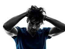 Silhueta do retrato do desespero da manutenção da dor de cabeça do homem do restolho Foto de Stock