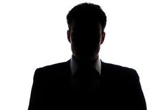 Silhueta do homem de negócios que veste um terno Fotos de Stock Royalty Free
