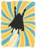A silhueta do super-herói voa acima através do grunge do redemoinho Fotografia de Stock Royalty Free
