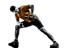 Silhueta do treinamento do peso de exercício do homem Foto de Stock Royalty Free