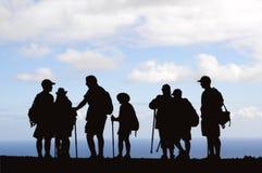 Silhueta dos caminhantes Fotografia de Stock Royalty Free