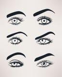 A silhueta dos olhos fêmeas abre, formas diferentes fotografia de stock royalty free