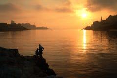 Silhueta dos pescadores Imagens de Stock Royalty Free